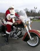 Papá Noël llega en moto